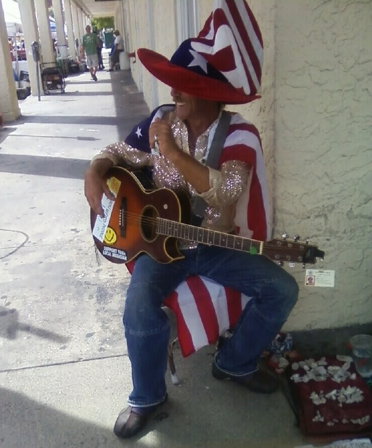 A street musician on Duval St. (photo by 7Mike5000 CC-BY-SA 3.0 Wikimedia Commons)