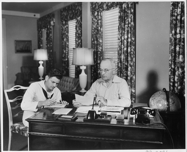 President Truman giving dictation to his assistant in the Little White House
